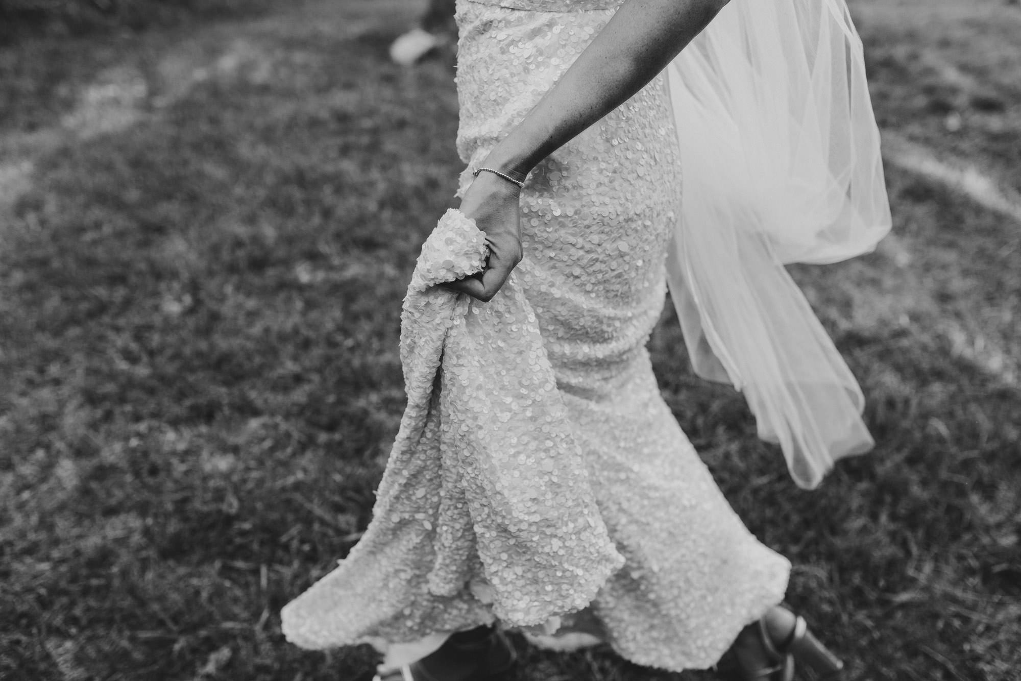 bride walking with dress
