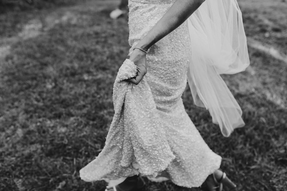 bride walking in white wedding dress