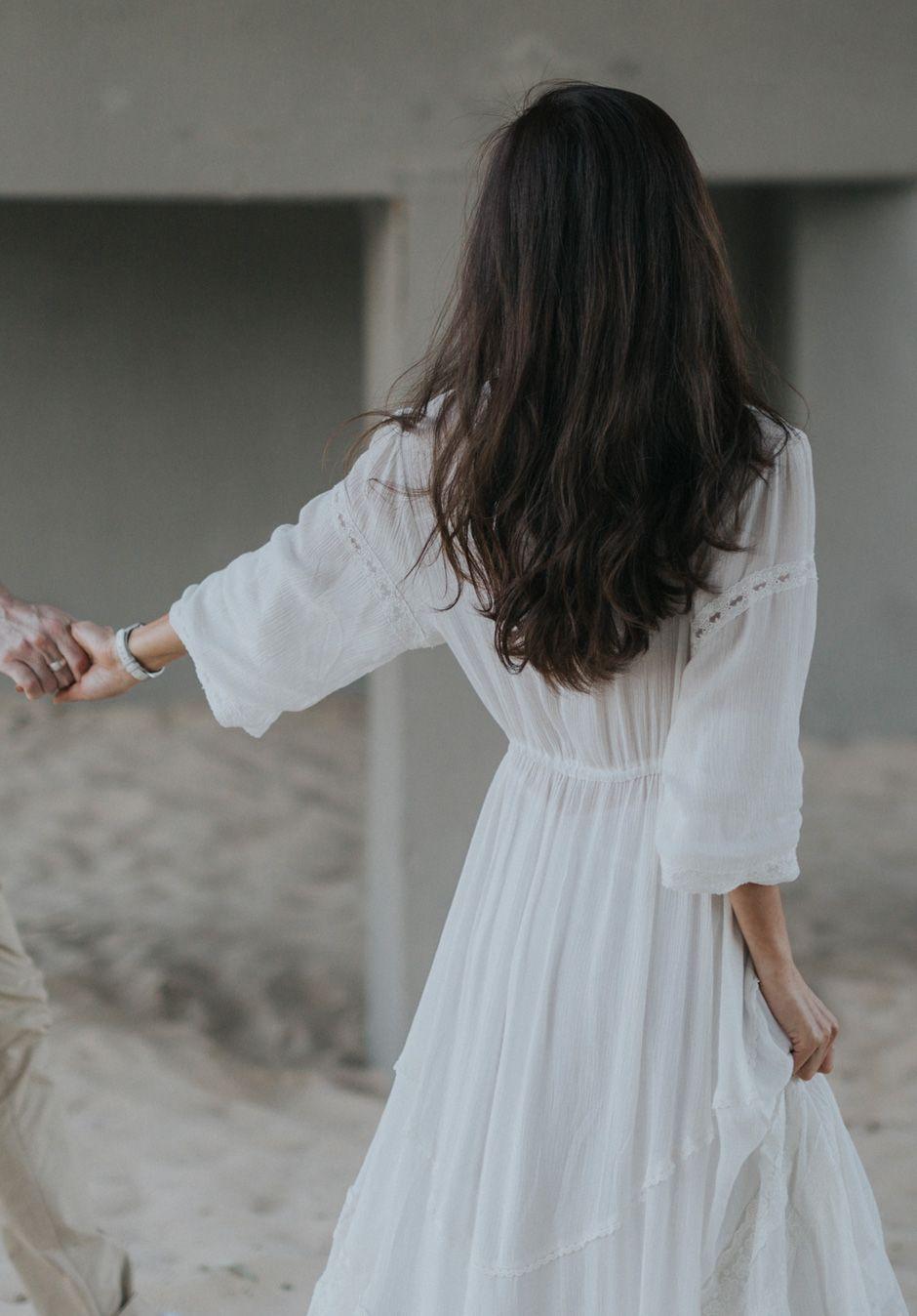 bride in white dress walking