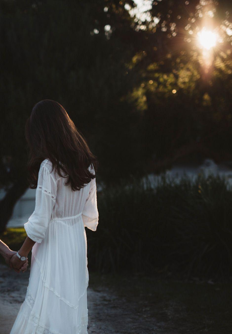 bride walking in sunlight