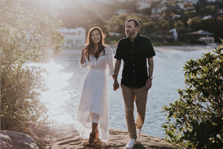 couple walking in sunshine